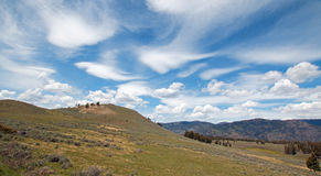 Rolling Hills under cirrus lenticular cloudscape in northern Yellowstone National Park Royalty Free Stock Photos