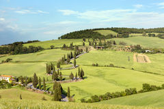 Rolling hills and winding roads in Tuscany. Rolling hills and winding road in Tuscany near Monticchiello royalty free stock images