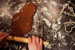 Rolling homemade gingerbread on the floured table. Stock Photos