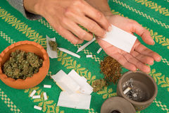 Rolling a joint Royalty Free Stock Image