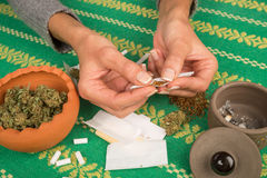 Rolling a joint Royalty Free Stock Images
