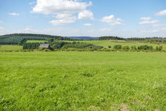 Rolling landscape with meadows. Royalty Free Stock Photography