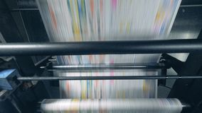 Rolling machine moves newspaper, automatic production. 4K stock video footage