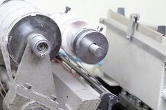 Rolling machine with paper in printing workshop Stock Photo