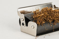 Rolling machine tobacco Royalty Free Stock Images