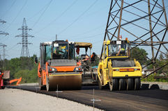 Rolling machineries making asphalt. Rolling machineries working and paving asphalt Stock Photo