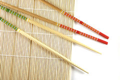 Rolling mat and chopsticks. Sushi rolling mat and chopsticks, macro stock image