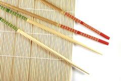 Rolling mat and chopsticks Stock Image