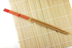 Rolling mat and chopsticks. Sushi rolling mat and chopsticks stock images