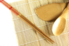 Rolling mat and chopsticks. Sushi rolling mat and chopsticks, macro royalty free stock photography