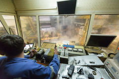 Rolling mill control cabin. Inside with worker Stock Photography