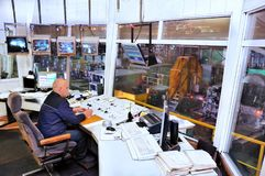 Rolling mill control room factory operator. Worker in manufacturing plant at machine control panel Stock Photo