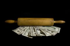 Rolling in the money Royalty Free Stock Image