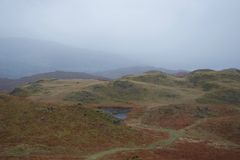 Rolling moorland with small lake tarn: typical of north Britain - English Lake District stock photography