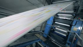 Rolling newspaper on a typographical conveyor, automated production. 4K stock video footage