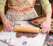 Rolling out dough for Baking Cookies Royalty Free Stock Photography