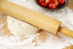 Rolling out dough for cherry pie Stock Images