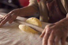Rolling out dough stock image