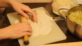 Rolling out dough with a rolling pin in hand stock video