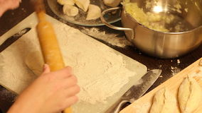 Rolling out dough with a rolling pin in hand stock video footage