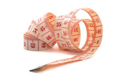 Rolling out a measuring tape. Isolated on white background, unravel on its side Royalty Free Stock Photography