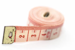 Rolling out measuring tape, on its side Royalty Free Stock Photos