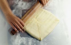 Rolling out the pastry. Food, gastronomy, cooking,cookery Stock Photo