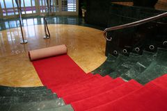 Rolling out the red carpet Stock Image
