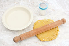 Rolling out shortcrust pastry for a pie Royalty Free Stock Photo