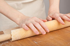 Rolling Pastry on Wooden Table Stock Photo