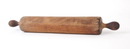 Rolling Pin. Antique wooden rolling pin, isolated royalty free stock image