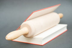 Rolling pin in a book Royalty Free Stock Photography