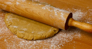 Rolling pin butter dough on the table Stock Photo