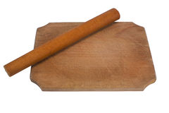 Rolling pin on chopping board Royalty Free Stock Photography