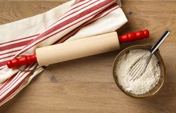 Rolling pin with classic red and white striped cotton dish towel