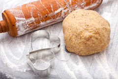 Rolling pin, cookie cutter and a dough ball Royalty Free Stock Images