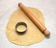 Rolling pin and cutter on fresh pastry, cutting out circles Stock Images
