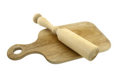 Rolling pin on cutting board Stock Photo
