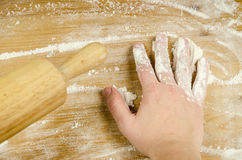 Rolling pin details with hand Royalty Free Stock Photos