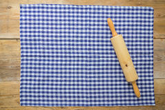 Rolling pin and dishcloth on rustic wooden background Royalty Free Stock Photos