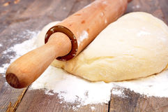 Rolling pin and dough Royalty Free Stock Image