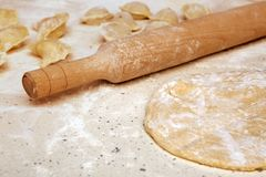 Rolling pin and dough on table Royalty Free Stock Photos