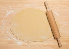 Rolling pin and dough Stock Images