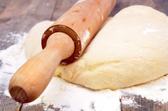 Rolling pin and dough Royalty Free Stock Photography