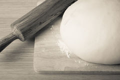 Rolling pin and dough on a wooden table. slightly tinted Stock Images