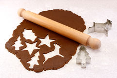 Rolling pin and festive cookie cutters with gingerbread dough Royalty Free Stock Photo