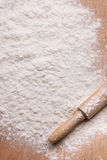 Rolling pin and flour. On the board Royalty Free Stock Images
