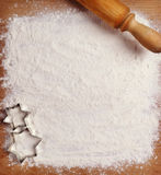 Rolling pin, flour and forms for cookies on the boards Royalty Free Stock Photo