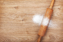 Rolling pin with flour on wooden table Royalty Free Stock Image