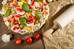 Rolling pin and fresh pizza Royalty Free Stock Photos